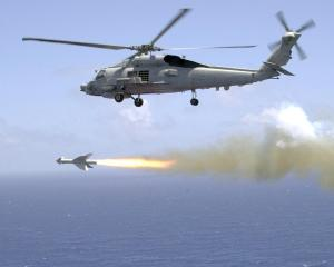 SH-60 fires a Penguin missile (DID)